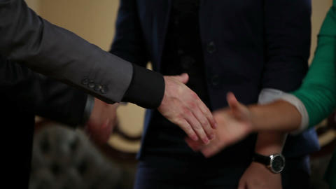 Business people shaking hands after a successful m Footage
