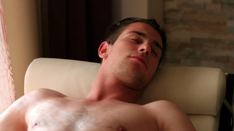 Close up of a young man relaxing, lying and sleepi Footage