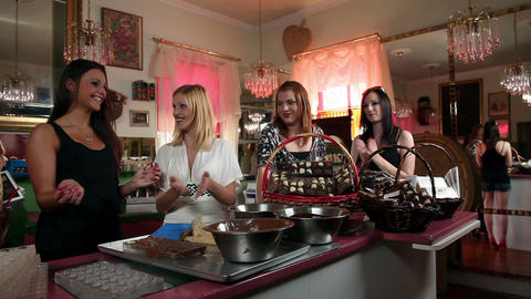 SHot of a four women making sweets in a boutique Footage