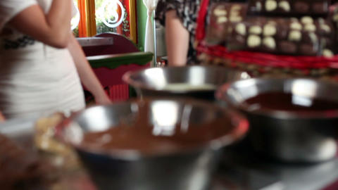 Shot of a four attractive young women making choco Footage