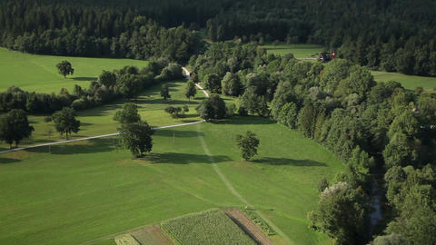 valley with fields, meadows, forest and few houses Footage