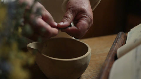 Close up of an old man making medicine from herbs Live Action