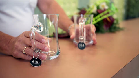 Close up shot of two glasses put on a board Footage
