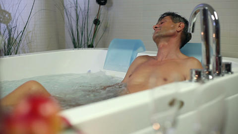 Shot Of A Man Enjoying Himself In Hot Jacuzzi In P stock footage