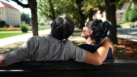 Shot Of A Couple Sitting On A Park Bench On A Beua stock footage