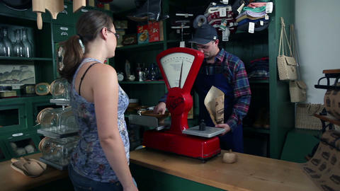 Young people who are buying in an old, retro shop Footage