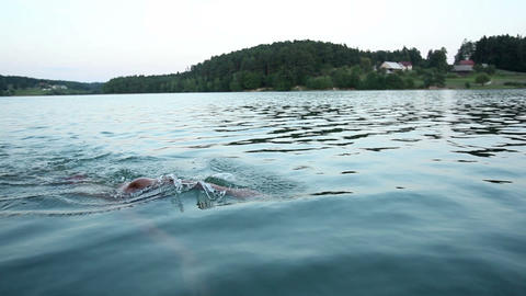 Man swimming towards the camera Footage