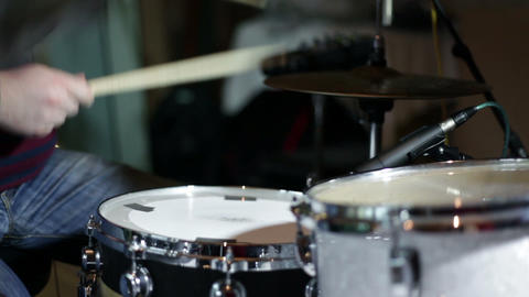 musican playing drums Live Action