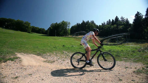 Young man fastly riding his bike downhill Footage