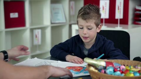 Young boy drawing in kindergarten Footage