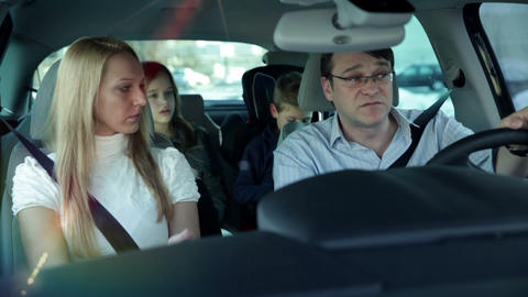 Family driving car searching for location with hel Footage