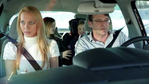 Family in car searching for vacation location Footage
