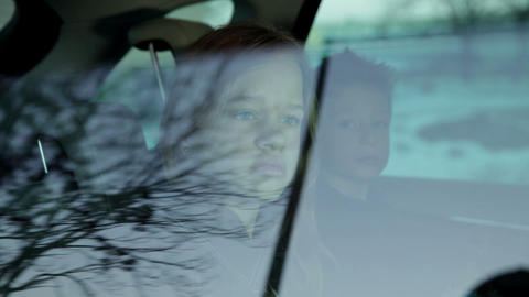 Close up shot of girl in car back seat closing the Live Action