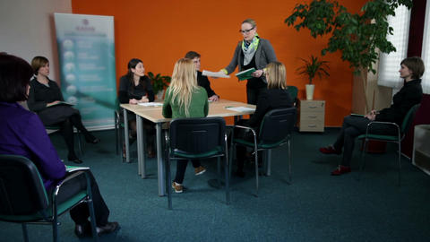 Wide shot of young business group starting meeting Live Action