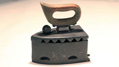 Very old ironing charcoal device Live Action