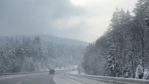 Frozen road and driving on a highway in winter tim Footage