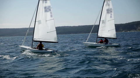 Sailboats preparing for competition in windy weath Footage