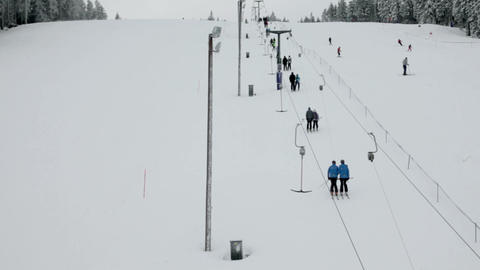 Idyllic ski slope, cableway with lots of people Footage