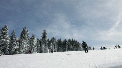 Ski slope with people skiing in winter idyll Footage