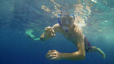 Man with diving equipment enjoying swimming in sea Footage