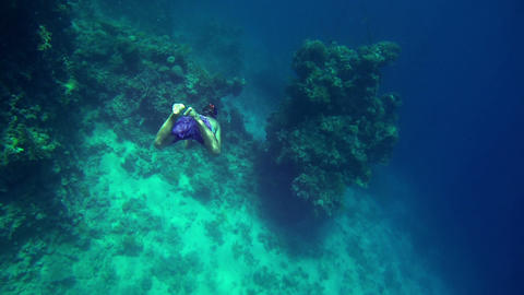 Young man with diving equipment diving in to deep  Footage