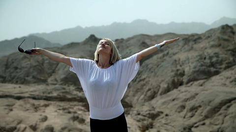 Woman enjoying the rocky landscape in Safari Footage