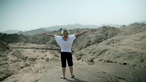 Woman absorbing sunshine energy in Safari landscap Footage