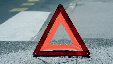Warning triangle on road Live Action