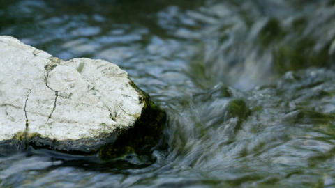 Extreme close up of rock in water stream Footage
