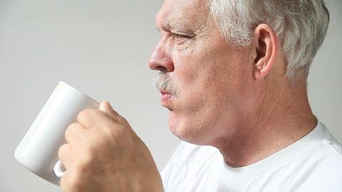 senior man drinking coffee Live Action