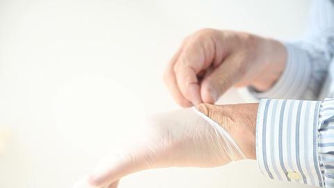 man putting on plastic medical gloves Footage