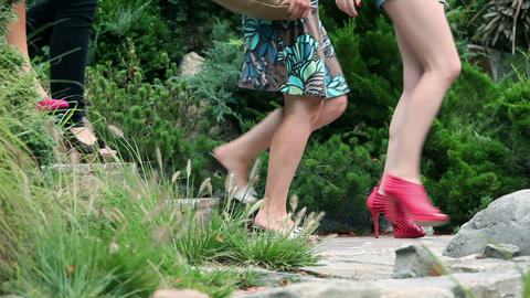 Close up on high heels of four woman walking in pa Footage