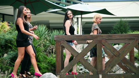 Four beautiful women in high heels walking over wo Footage