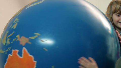 Kids playing with Earth globe Footage