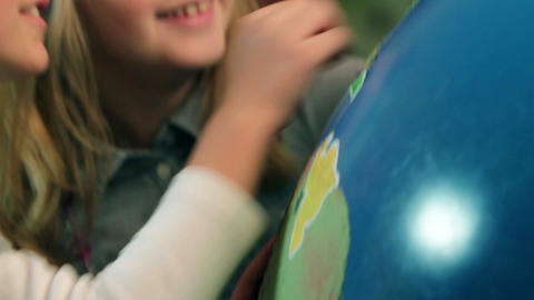 Close up of Earth globe and kids learning Geograph Footage