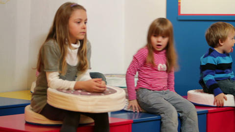 Bunch Of Kids In Kindergarten Playing With Pillows stock footage