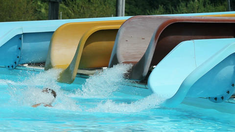Number of water slides with kids rushing down Footage