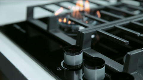 Gas cooker in kitchen with digital buttons Footage