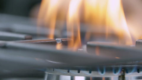 Changing the intensity of fire on gas cooker Footage