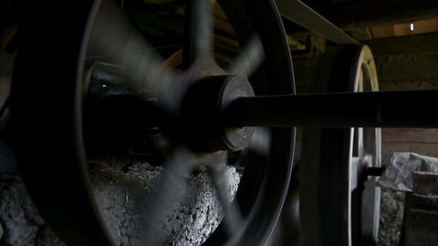 Close up on spinning wheels of watermill Footage
