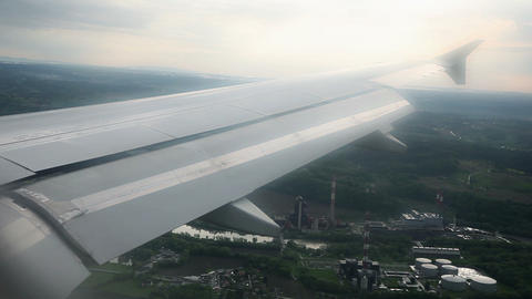 Airoplane Wing While Flying Over City stock footage
