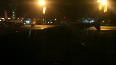 Airplane wing shot from window before taking off a Footage
