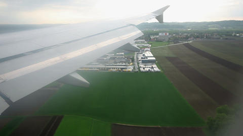 View from airoplane while flying over farms with f Footage