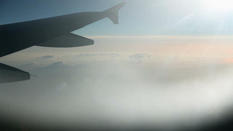 Flying above the clouds with airplane Footage