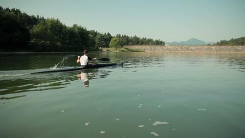 Zoom On Man Kayaking To Turning Point In Lake stock footage