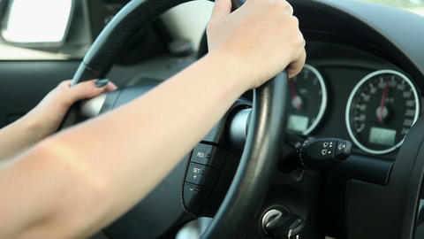 Woman Driving Car Detail On Steering Wheel stock footage