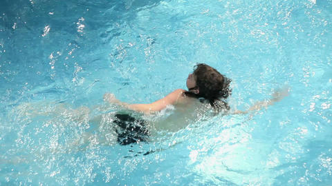 Kids enjoying refreshing in pool Footage