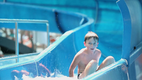 Kids comming down the waterslide quicly moving awa Footage