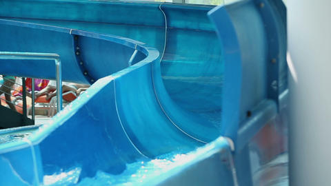 Close up on waterslide while group of kids sliding Footage
