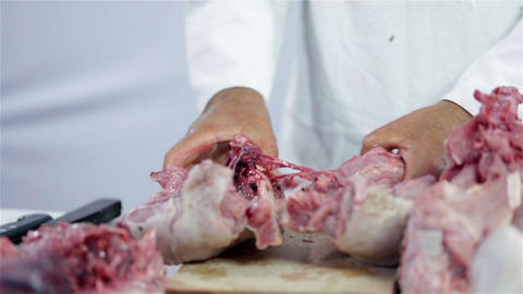 Chopping Hard Bones Of Turkey Meat With Hammer stock footage